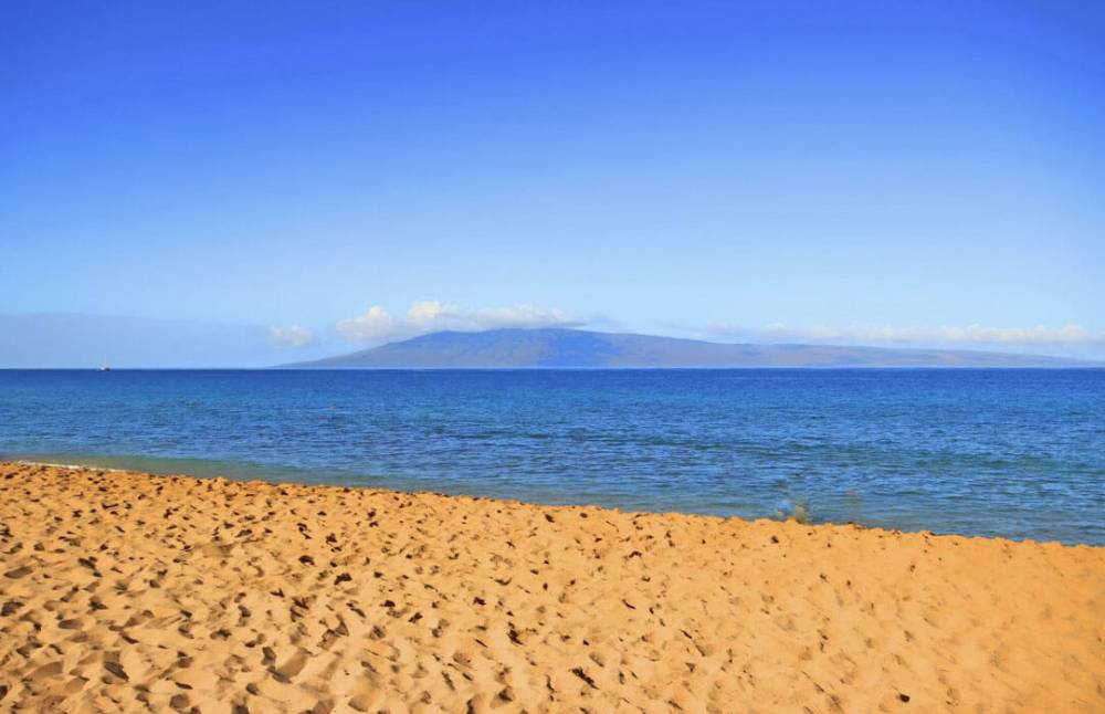 Touch your toes in the soft sands of Kaanapali North Beach