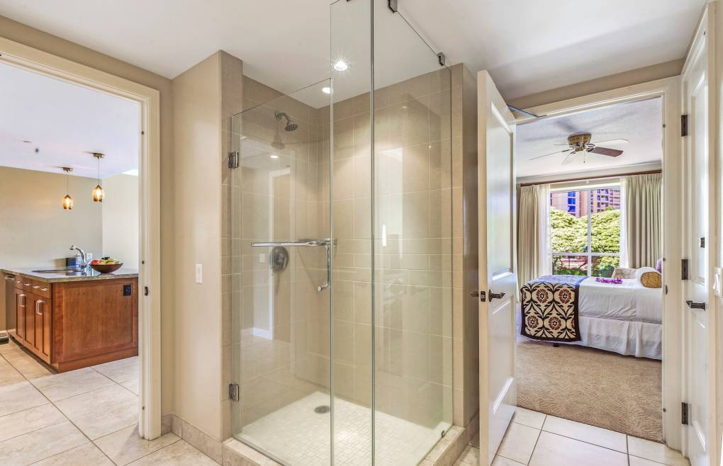 With a glass walk-in shower