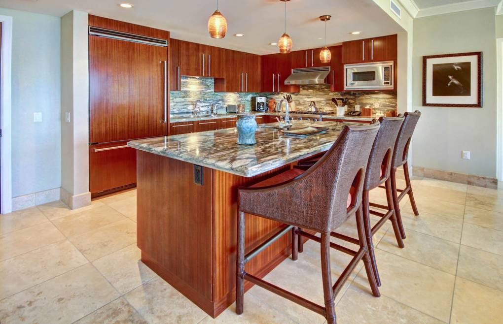 Featuring a chef's kitchen with Viking appliances and a built-in wine chiller