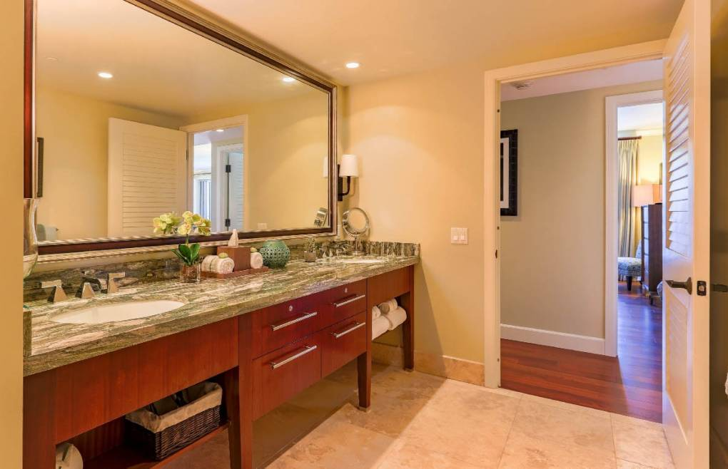 Luxurious guest bathroom with double granite vanity