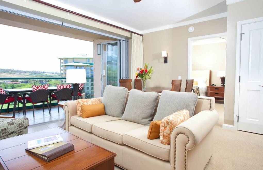 The living room features a queen convertible sofa sleeper