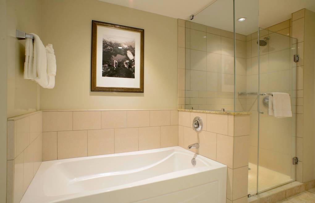 With an elegant walk-in shower and separate soaking tub