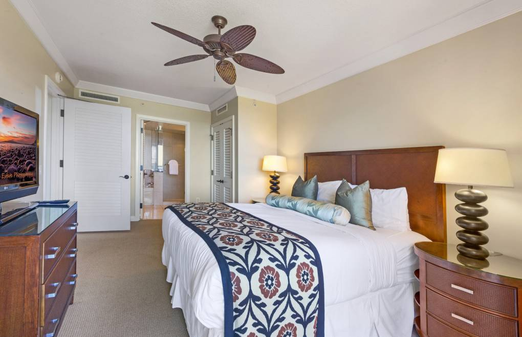 First master bedroom features a king size bed