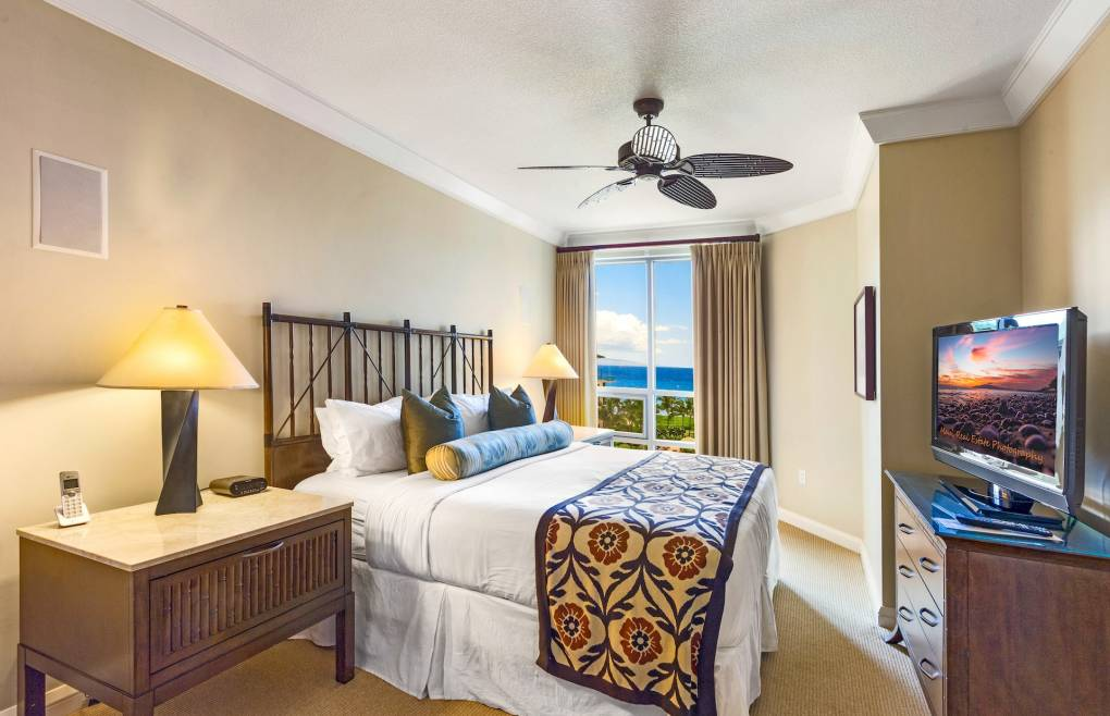 Second master bedroom features a king size bed