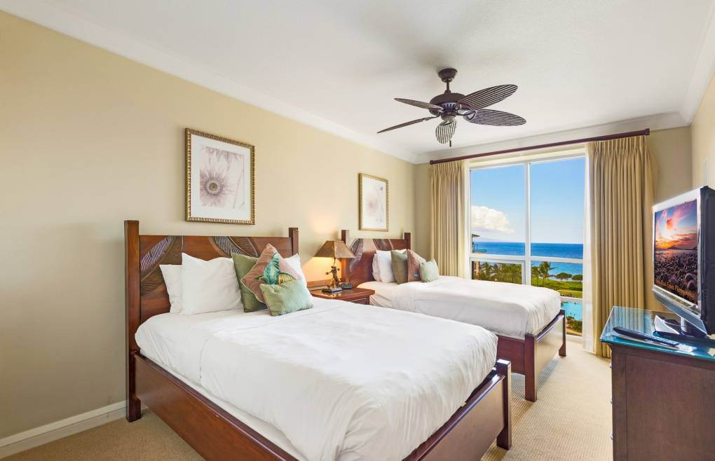 Guest bedroom offers the convenience of two queen size beds