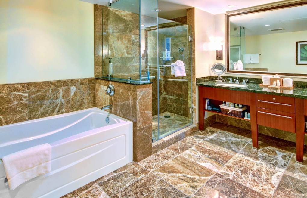 The first master bath also offers a separate soaking tub