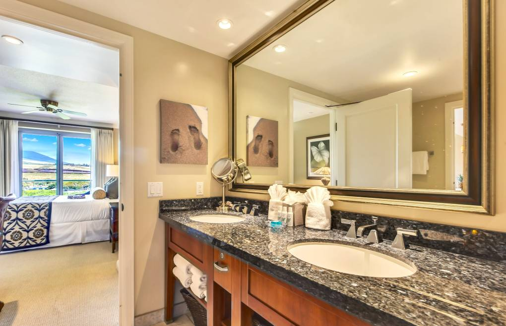 The master bathroom features a double granite vanity
