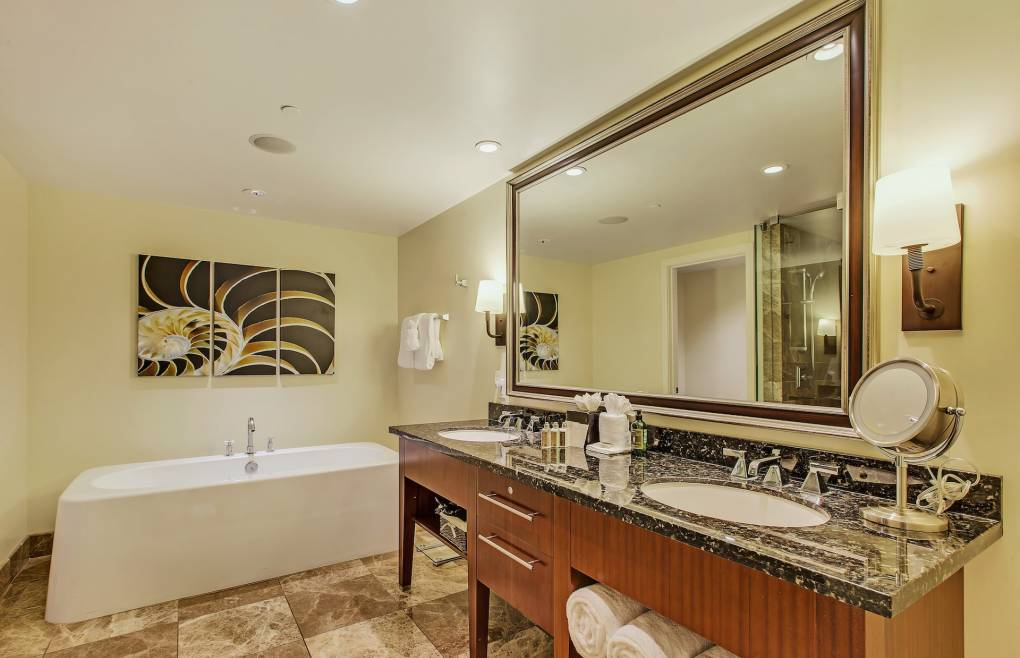 The luxurious master bathroom features an elegant freestanding tub