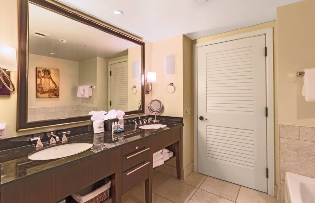 Second master bathroom features a double granite vanity