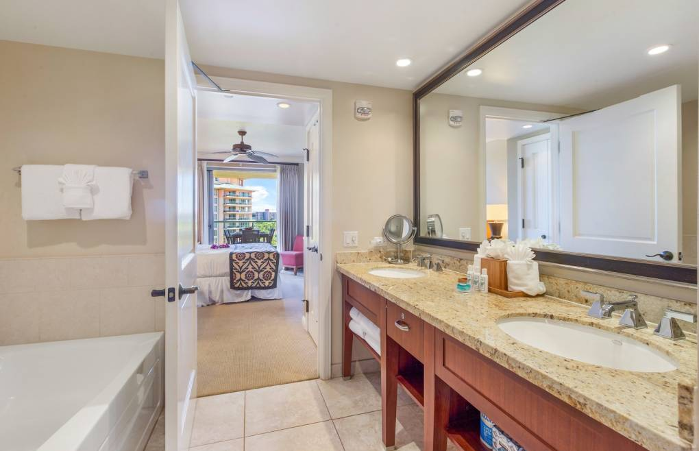 The master bathroom offers a double granite vanity