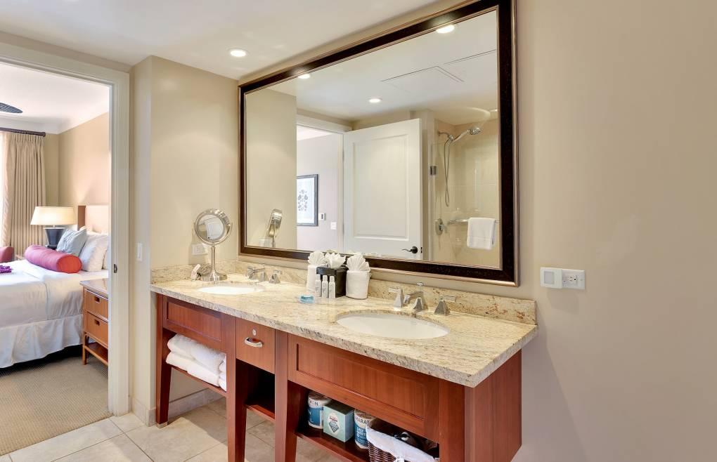 Second bathroom has a double granite vanity