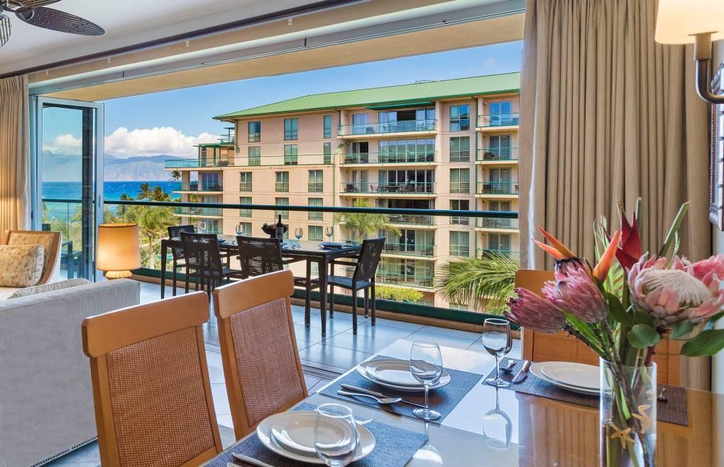 Open the retractable glass doors for a relaxing indoor/outdoor living experience