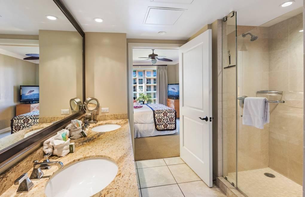 First bathroom has a double granite vanity