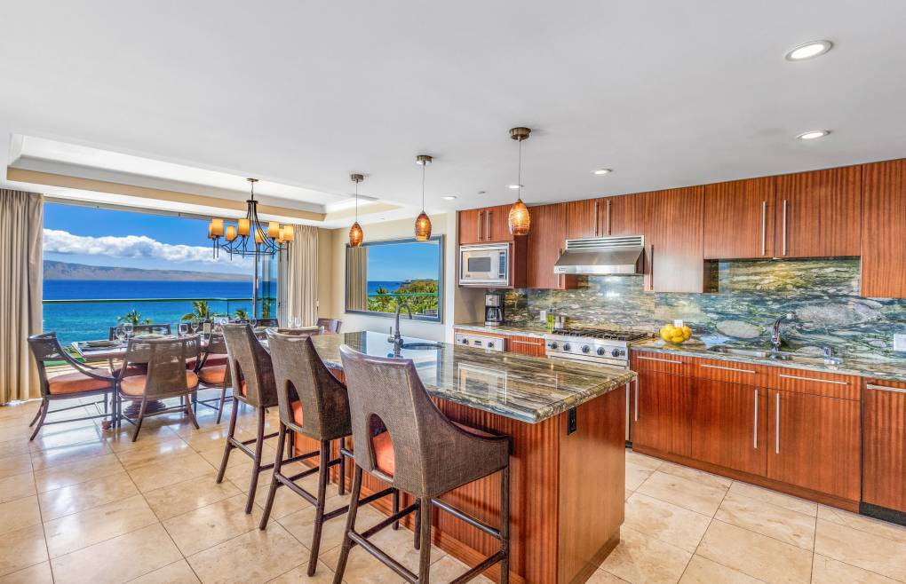 With gorgeous oceanfront views from the kitchen, dining, and living room