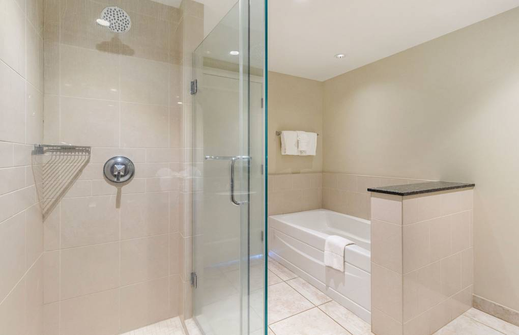 Also with a frameless glass walk-in shower and a separate soaking tub