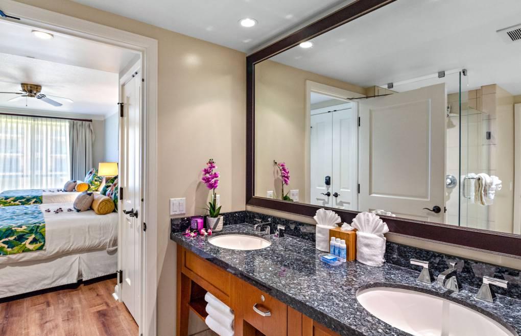 Guest bathroom has a double granite vanity