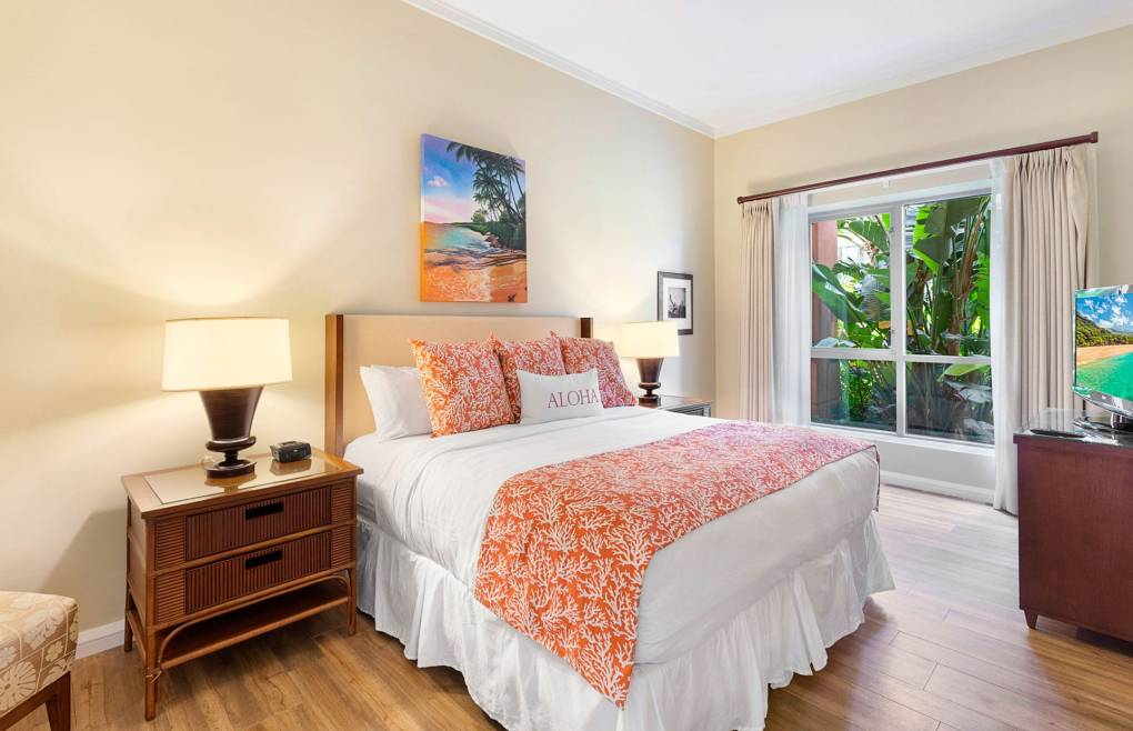 The spacious guest bedroom features a king size bed