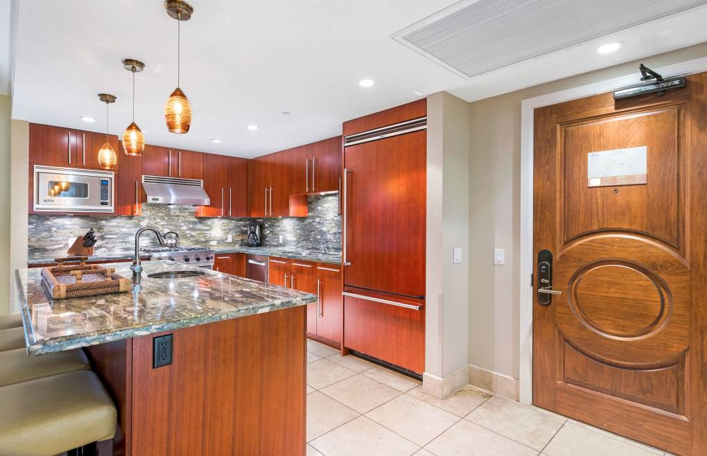 With Viking appliances, granite counters, dual ovens, and a built-in wine fridge