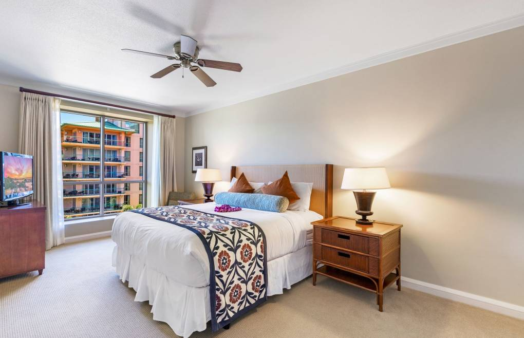 The guest bedroom also features a king-size bed