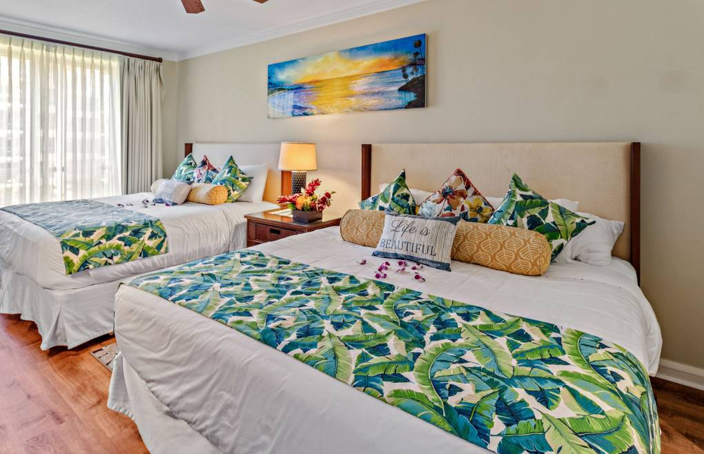 The guest bedroom has been upgraded with two king-size beds
