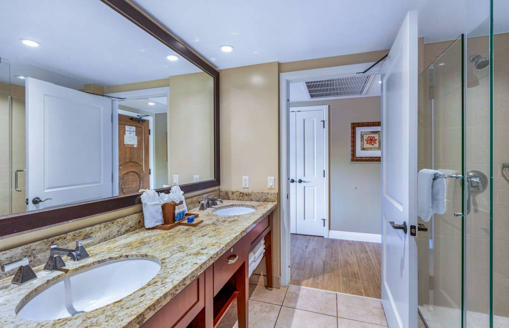 Guest bathroom with double vanity and frameless glass walk-in showe