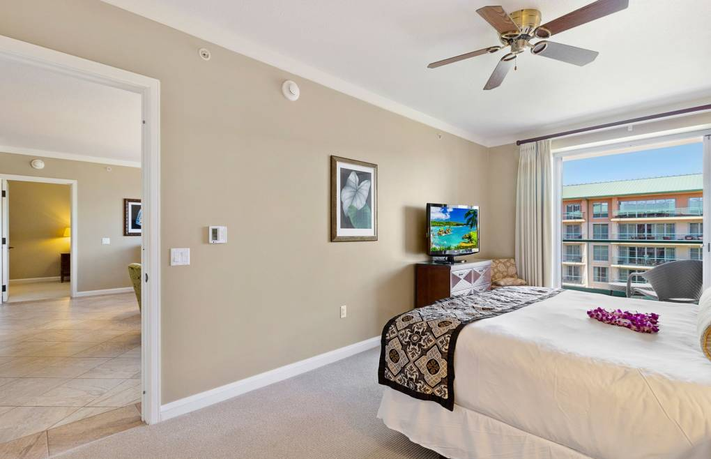 The master bedroom offers balcony access