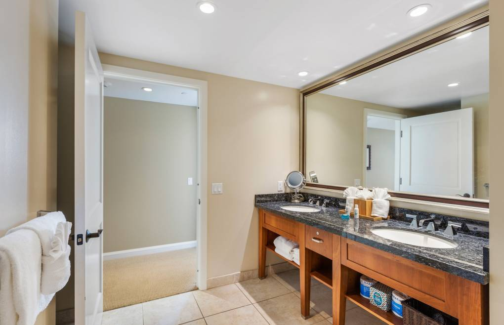 The guest bathroom also offers a double granite vanity