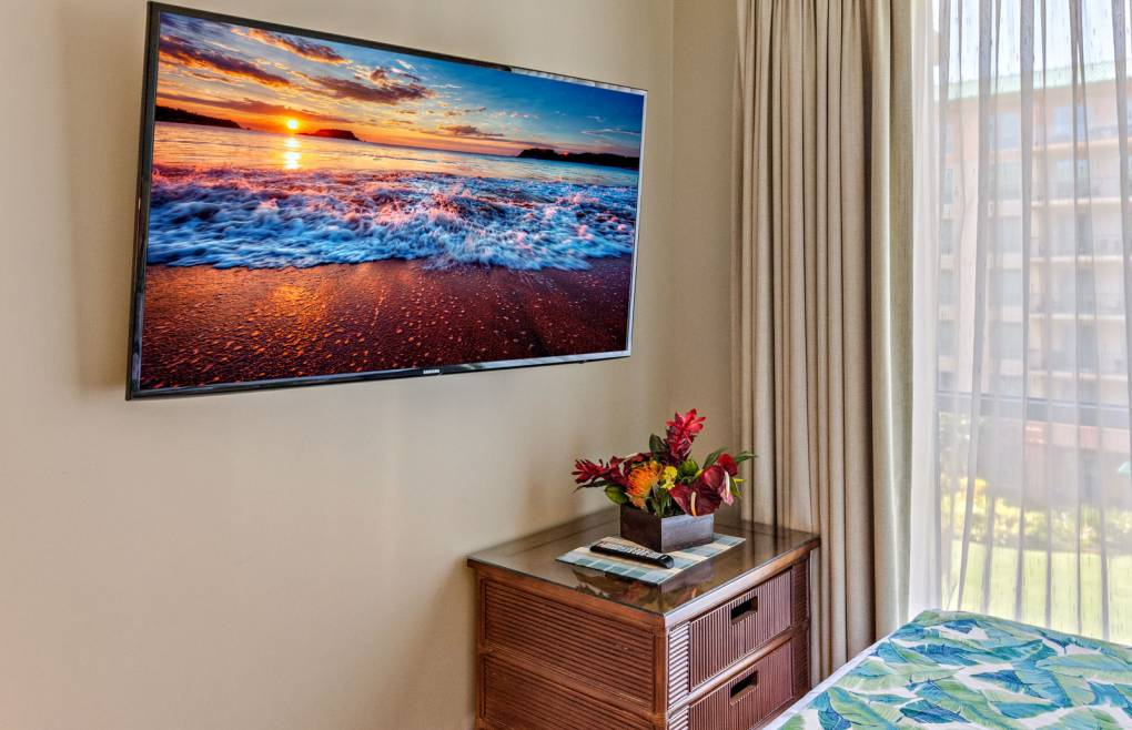 """Each bedroom features an upgraded 50"""" wall-mounted flat panel TV"""