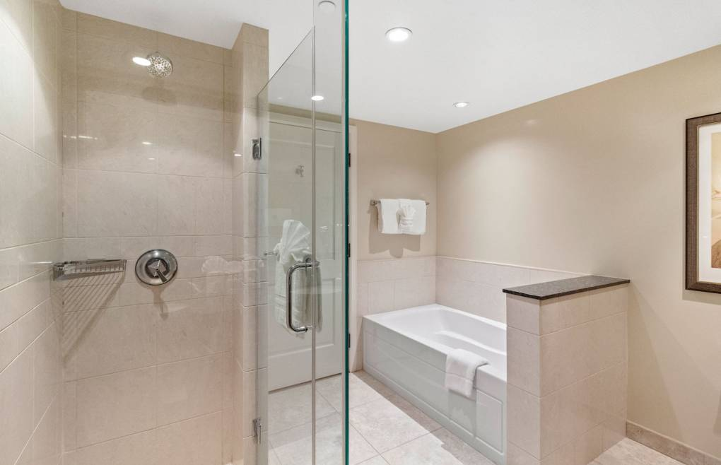 With a glass walk-in shower and soaking tub