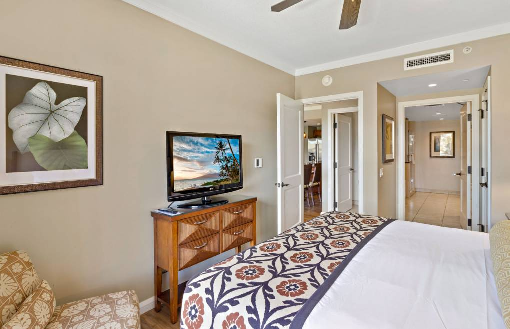 The master bedroom features a sumptuous king size bed