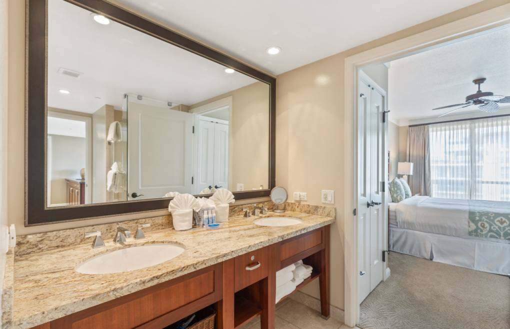 The guest bathroom features a double granite vanity