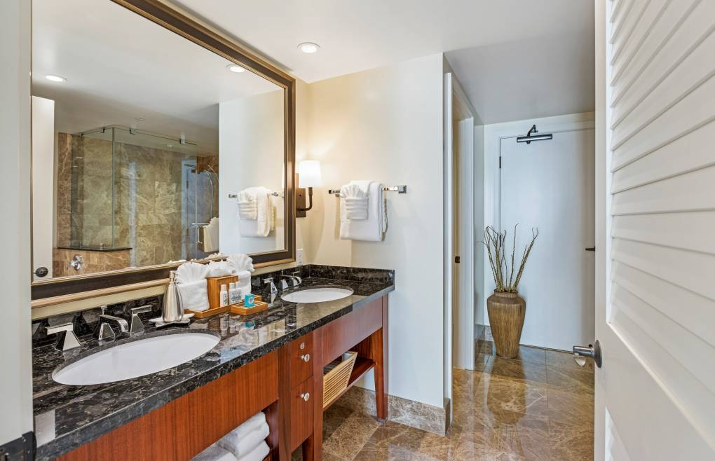 The second master bathroom offers a double granite vanity