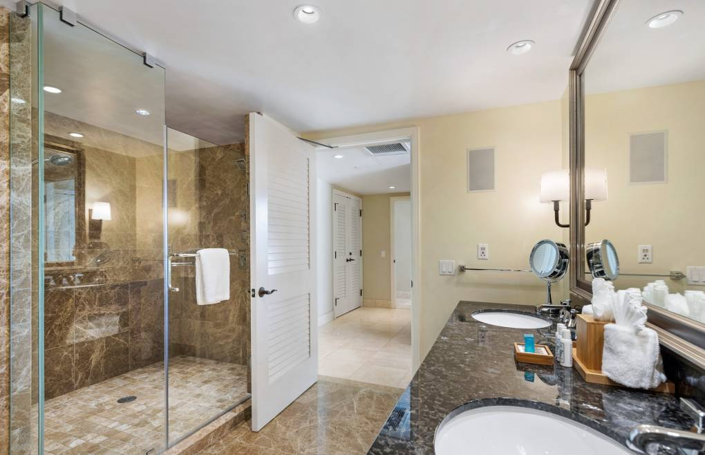 With an elegant freestanding tub and an oversize glass and marble walk-in shower