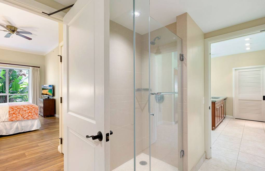The guest bathroom has a glass walk-in shower