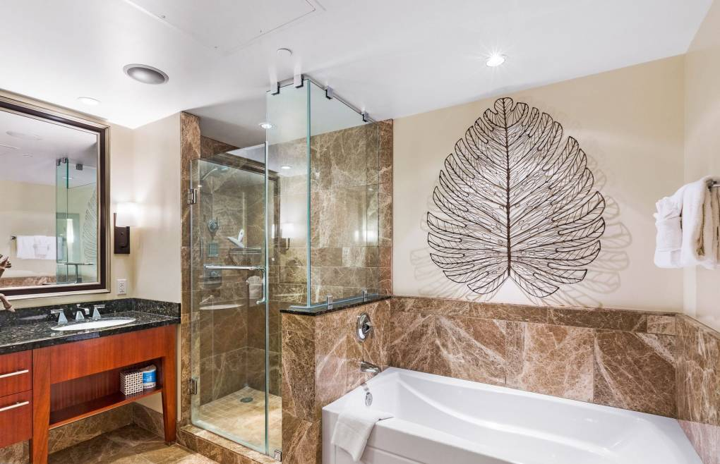 Also offering an oversize frameless glass walk-in shower and a separate soaking tub