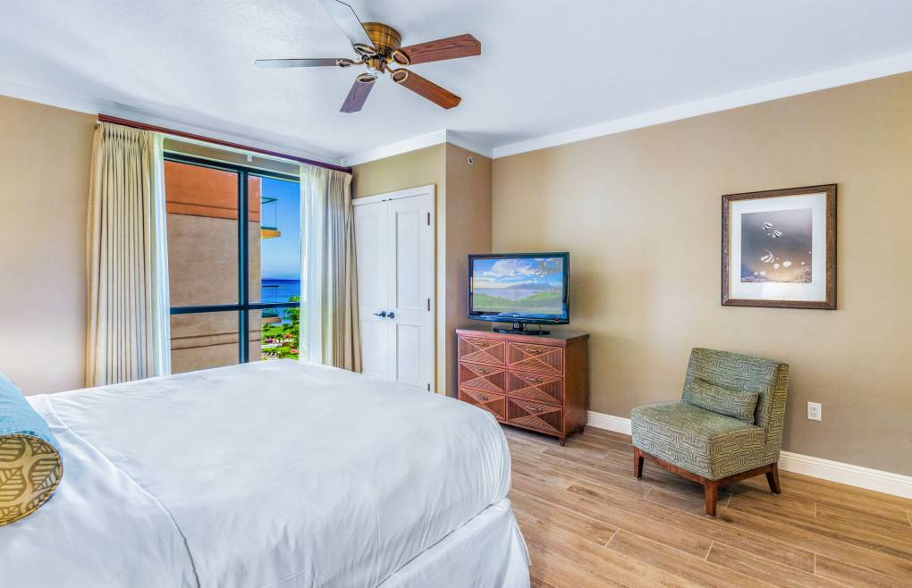 The guest bedroom even features some ocean views right from the king size bed