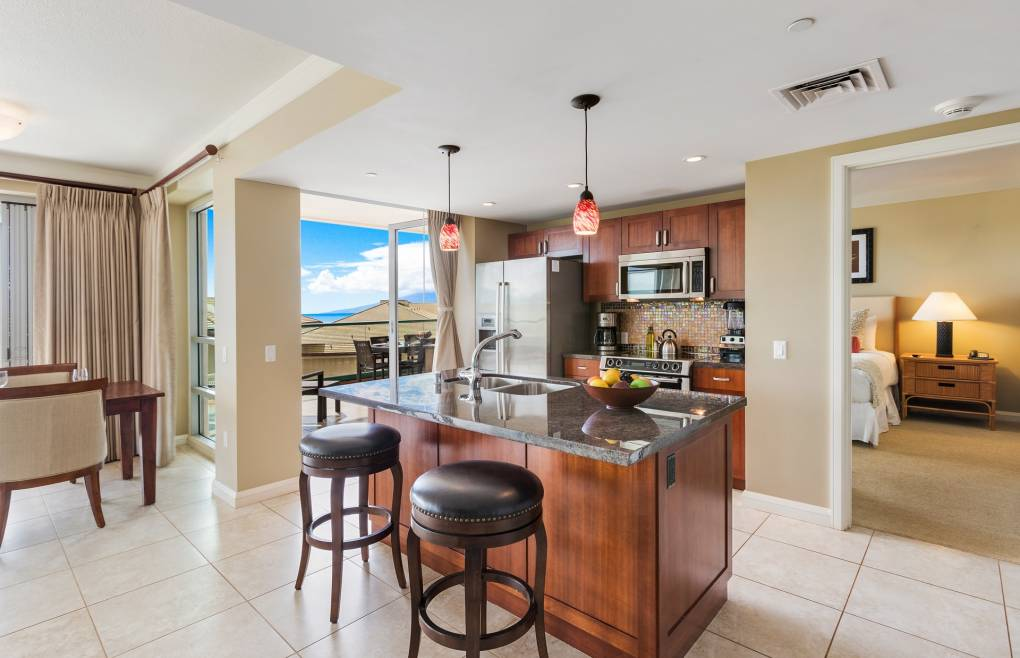 Featuring granite counters, stainless appliances, and all the necessary cookware
