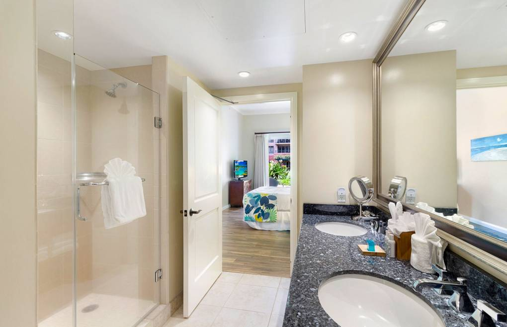 The master bath also features a frameless glass walk-in shower