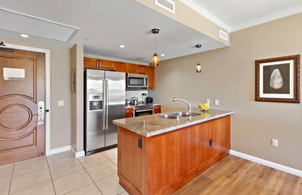 Featuring granite counters, Bosch appliances, and all the necessary cookware