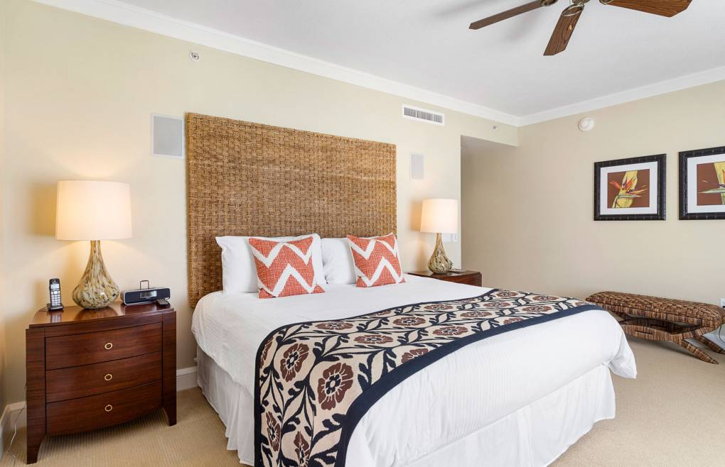 The spacious master bedroom features a king-size bed