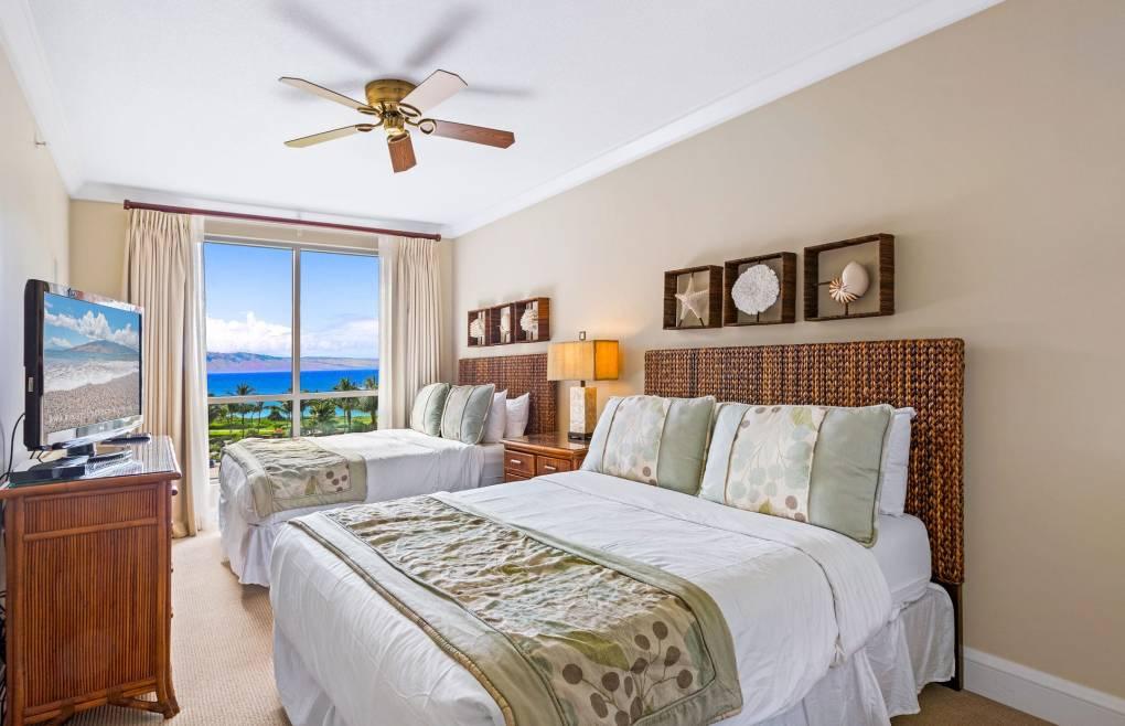 The guest bedroom features 2 comfy queen beds