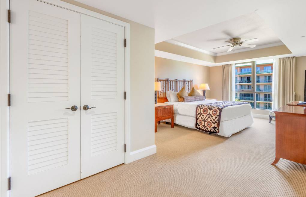 The second master bedroom offers a king-size bed