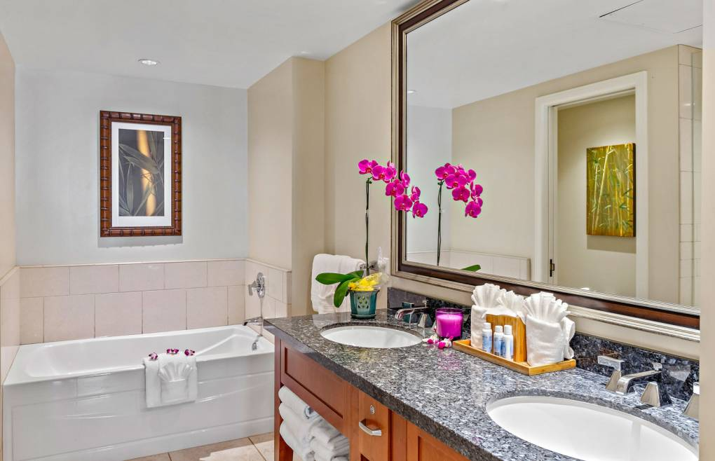 The master bath offers a double granite vanity
