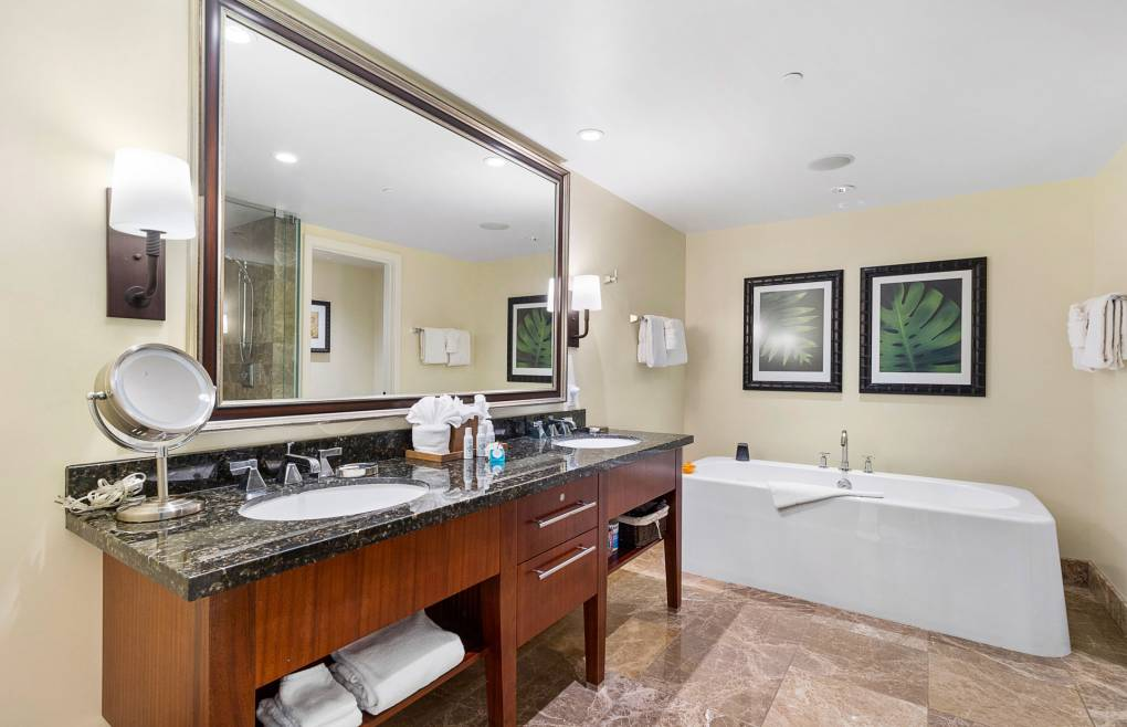 The luxurious master bath offers a double granite vanity